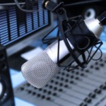 Radio - A mic in front of the control panel in broadcasting studio