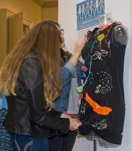 Visitors making their mark on the Graffiti Shift Dress at Select Showcase Photo Credit: Penny Wheeler